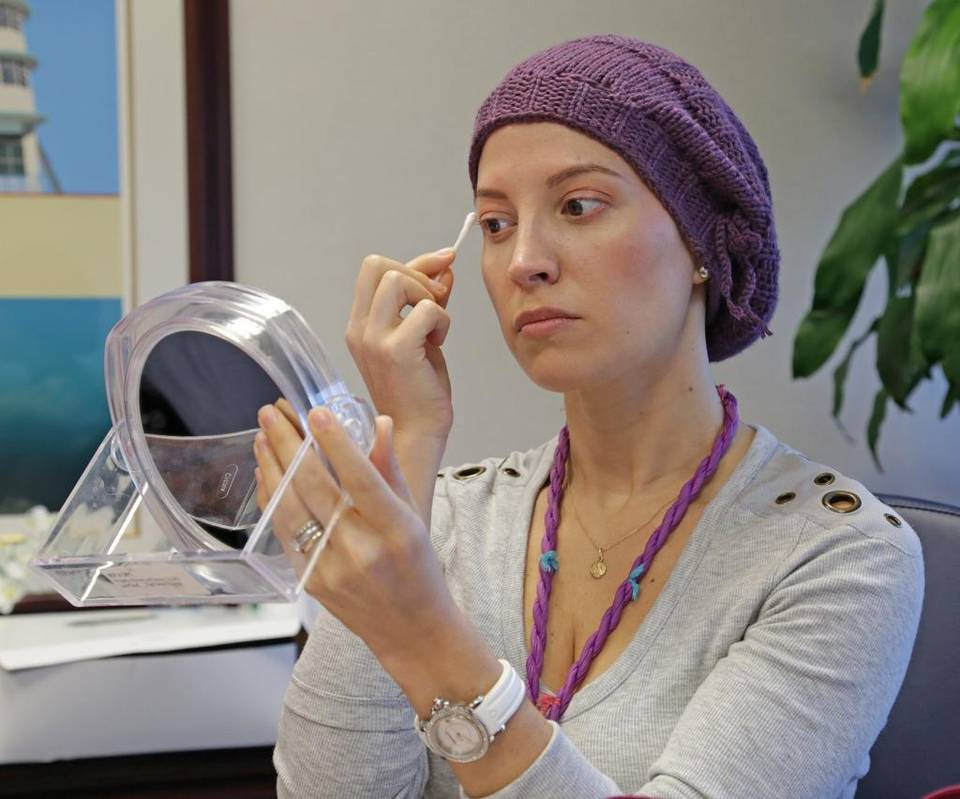 Photo Caption: Just a touch: Alexandra Phelan, 33, applies makeup during a 'Look Good, Feel Better' event hosted by the American Cancer Society at Mount Siani Medical Center in Miami Beach on May 4. (MATIAS J. OCNER/MIAMI HERALD STAFF)