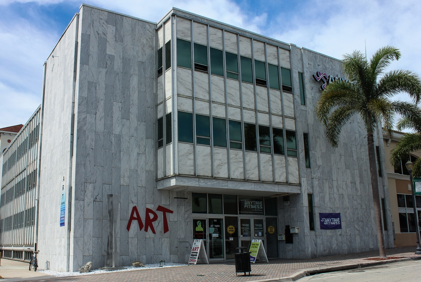 The building on Orange Avenue in downtown Fort Pierce, which houses Art Mundo and Anytime Fitness recently was acquired by Steve Tarr and his company, OneEleven LLC. (CRYSTAL CHEW/TREASURE COAST NEWSPAPERS)
