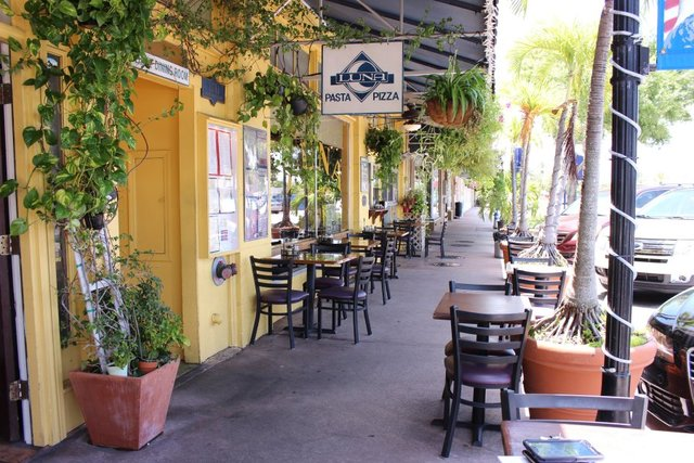 Luna Italian Restaurant on Flagler Avenue in Downtown Stuart has a maximum capacity of 50 people inside, tables for outdoor seating and a sidewalk takeout window. (Crystal Chew/Treasure Coast Newspaper)