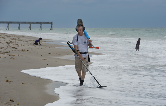 """Mitch King, a member of the Treasure Coast Archeological Society, says he visits the beach several evenings a week to metal detect on the beach. """"We try to go down at low tide because it gives you more access to the lower parts of the beach where people were swimming earlier,"""" said King, adding that he tries to return jewelry, such as rings, to their original owners whenever possible. (SAM WOLFE/TREASURE COAST NEWSPAPERS)"""